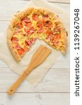 pizza cheese board on a wooden... | Shutterstock . vector #1139267048