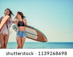 surfers on beach having fun in... | Shutterstock . vector #1139268698