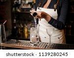 bartender girl in the white... | Shutterstock . vector #1139280245
