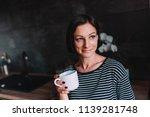 woman wearing striped shirt... | Shutterstock . vector #1139281748