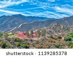 Red Fire Retardant Covers Hills ...