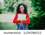 portrait of smiling young black ... | Shutterstock . vector #1139286512