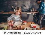 girl having breakfast at home... | Shutterstock . vector #1139291405