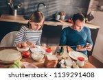 daughter having breakfast while ... | Shutterstock . vector #1139291408