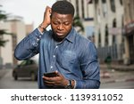 young african man standing in... | Shutterstock . vector #1139311052
