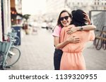 positive girl hugging female... | Shutterstock . vector #1139320955