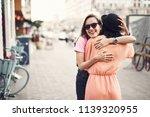positive girl hugging female... | Shutterstock . vector #1139320955