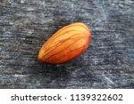 almond on wooden background | Shutterstock . vector #1139322602