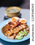 rice with bbq pork and crispy...   Shutterstock . vector #1139348345