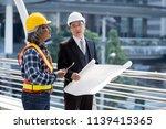 engineer and businessman... | Shutterstock . vector #1139415365