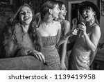 group of young laughing stylish ... | Shutterstock . vector #1139419958