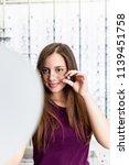 beautiful teenage girl choosing ...   Shutterstock . vector #1139451758