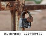 old iron rusty lock on the gate.... | Shutterstock . vector #1139459672