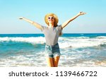 happy smiling woman enjoys the... | Shutterstock . vector #1139466722