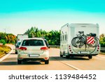 rv camper with bicycles and car ...