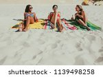 three girlfriends sitting on... | Shutterstock . vector #1139498258