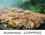 preparation of a shish kebab... | Shutterstock . vector #1139499302