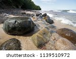 Wet Rocks On A Beach In The...