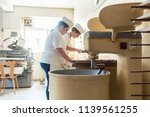 close up on baker in bakery... | Shutterstock . vector #1139561255