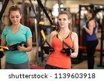 womans making trx fitness...   Shutterstock . vector #1139603918