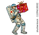 cosmonaut with gift box.... | Shutterstock .eps vector #1139613032