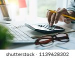 businessman with calculator... | Shutterstock . vector #1139628302
