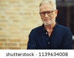 content senior man with a beard ... | Shutterstock . vector #1139634008