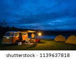 KHAO-ITO, THAILAND - December 04 2017: Family travel camping near swamp in sky night with classic van, Asian travel picnic near swamp in holiday trip. - stock photo