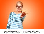 senior beautiful woman with a... | Shutterstock . vector #1139659292