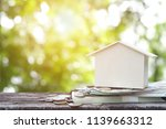 house model wooden and pile of... | Shutterstock . vector #1139663312
