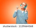 senior beautiful woman... | Shutterstock . vector #1139664368