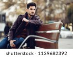 thoughtful young man sitting on ... | Shutterstock . vector #1139682392