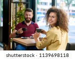 smiling couple having date in... | Shutterstock . vector #1139698118