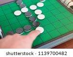 closeup discs on green reversi... | Shutterstock . vector #1139700482