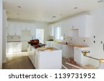 Stock photo installing new induction hob in modern kitchen 1139731952