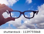 hand holding glasses between... | Shutterstock . vector #1139755868