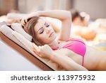 woman sunbathing in bikini at... | Shutterstock . vector #113975932