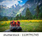 hiking boots and mountains... | Shutterstock . vector #1139791745