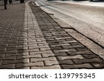 the pavement in the town early... | Shutterstock . vector #1139795345