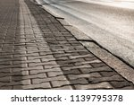 the pavement in the town early... | Shutterstock . vector #1139795378