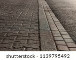 the pavement in the town early... | Shutterstock . vector #1139795492