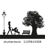 girl with a baby in the park | Shutterstock . vector #1139814308