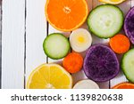sliced fruits and vegetables on ... | Shutterstock . vector #1139820638