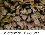 pile of firewood backgrounds... | Shutterstock . vector #1139822552