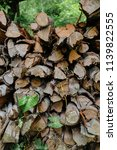 pile of firewood backgrounds... | Shutterstock . vector #1139822555