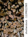 pile of firewood backgrounds... | Shutterstock . vector #1139822585