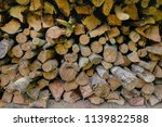 pile of firewood backgrounds... | Shutterstock . vector #1139822588