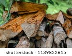 pile of firewood backgrounds... | Shutterstock . vector #1139822615