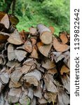 pile of firewood backgrounds... | Shutterstock . vector #1139822642