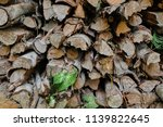 pile of firewood backgrounds... | Shutterstock . vector #1139822645